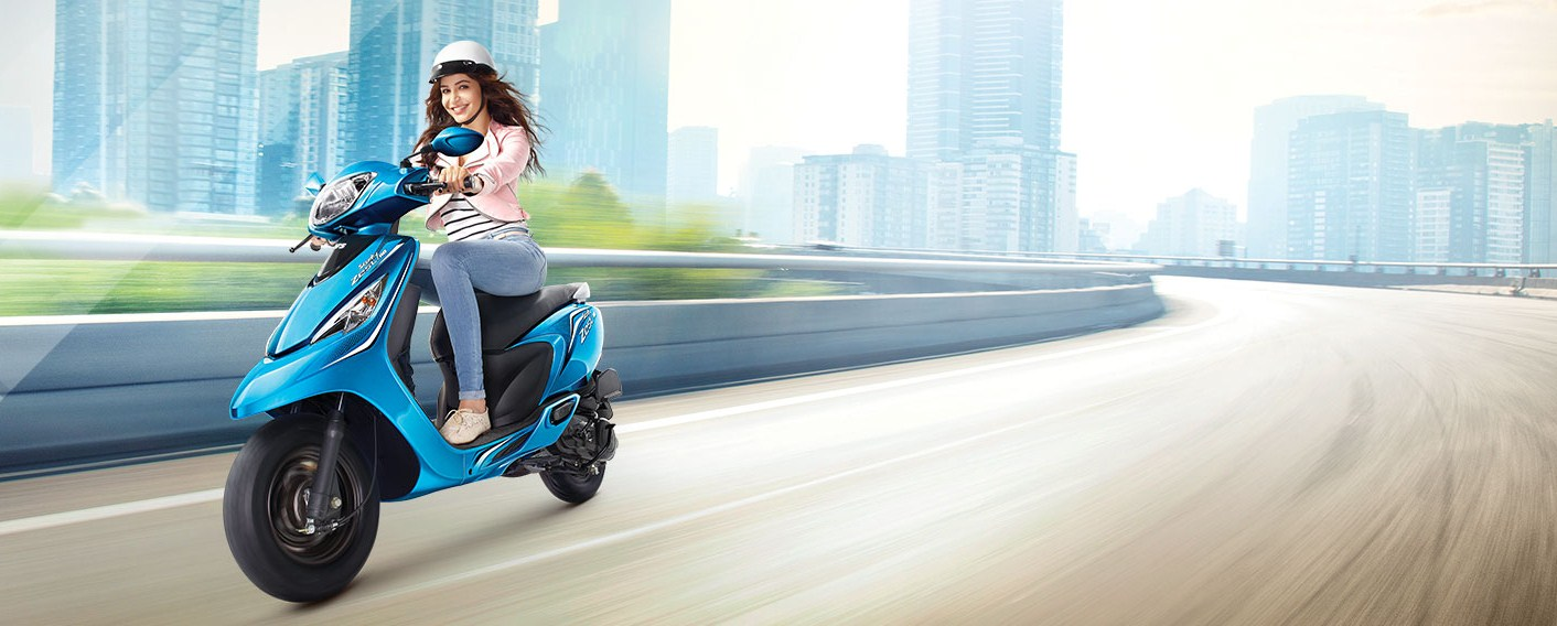 Anushka Sharma in TVS Scooty Zest 110