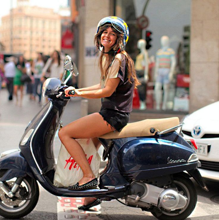 Lady Rider With Open Face Helmet on Scooter